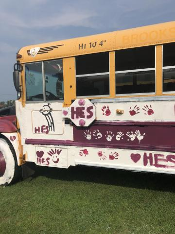 School bus painted by HES families for the derby